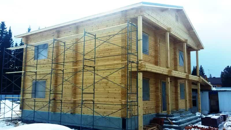 Дом из профилированного бруса с балконом